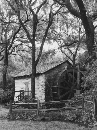 black and white water wheel grist mill
